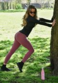 Maria Wild shows off her toned figure during an outdoor workout session at a park in in London, UK