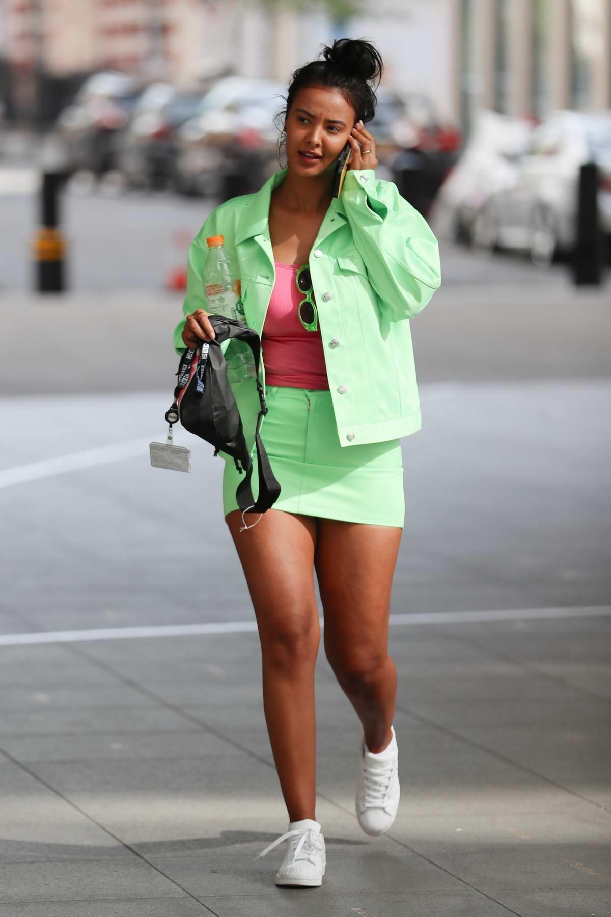 Maya Jama flaunts her legs in mint-green miniskirt while leaving BBC Radio One in London, UK