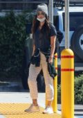 Megan Fox looks cool in striped pants during a trip to the local CVS Pharmacy in Woodland Hills, California