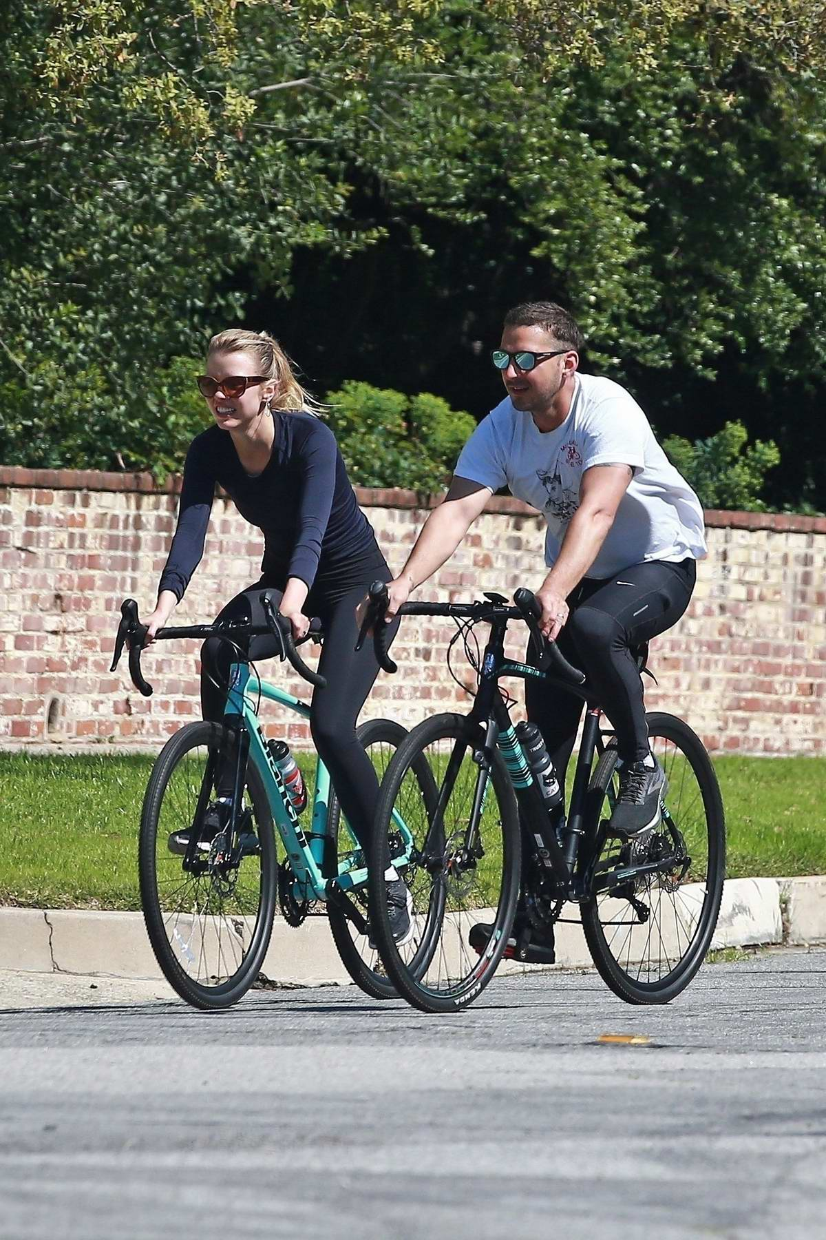 Mia Goth and Shia LaBeouf get back on their bikes and go for a ride around their neighborhood in Pasadena, California