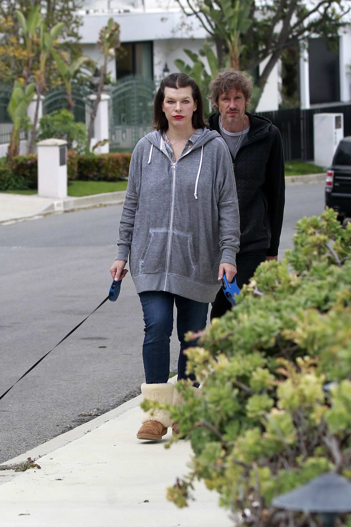 Milla Jovovich and husband Paul Anderson seen walking their dogs in Beverly Hills, California