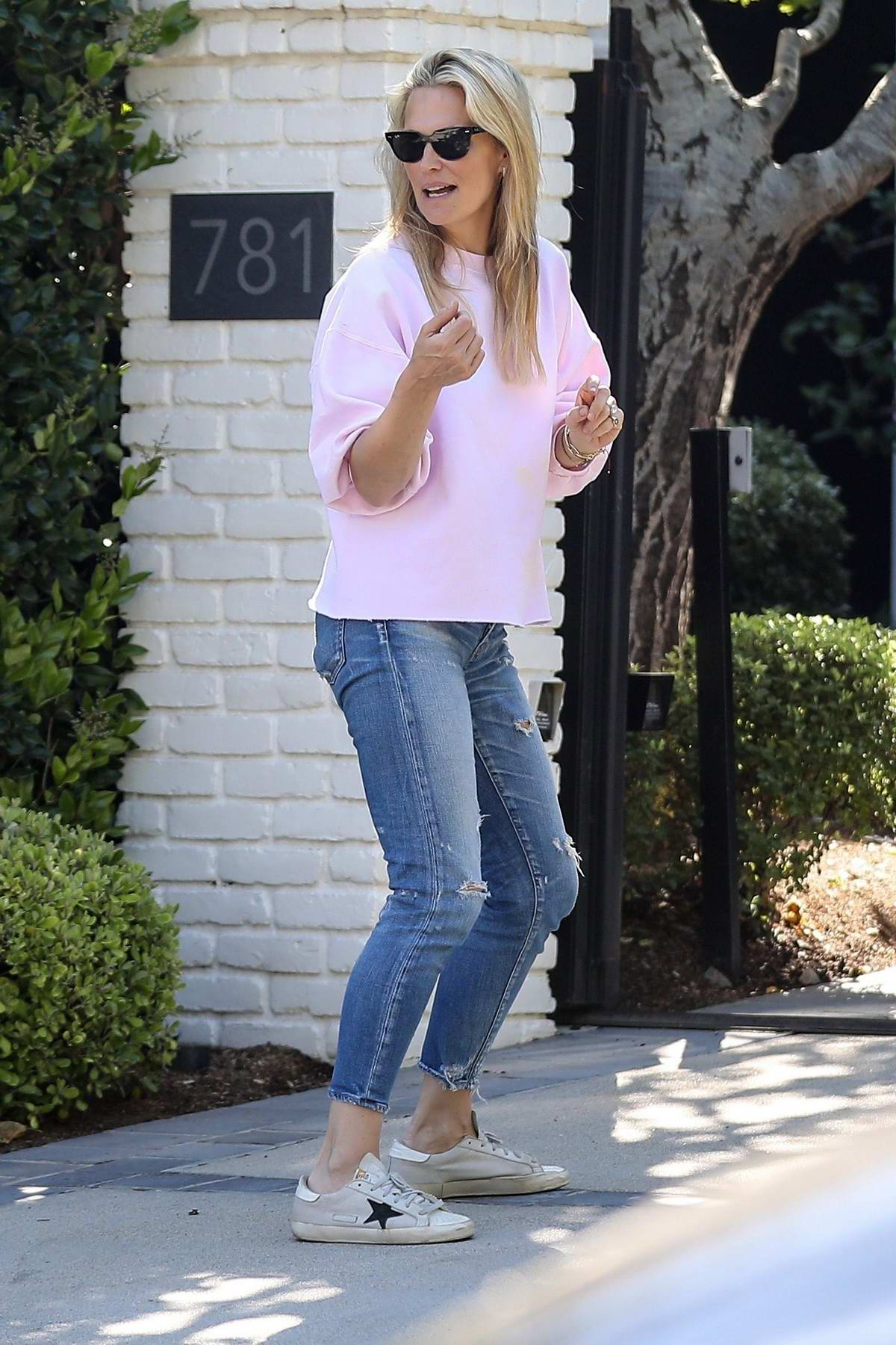 Molly Sims seen outside her home as she receives a delivery during stay-at-home order in Pacific Palisades, California