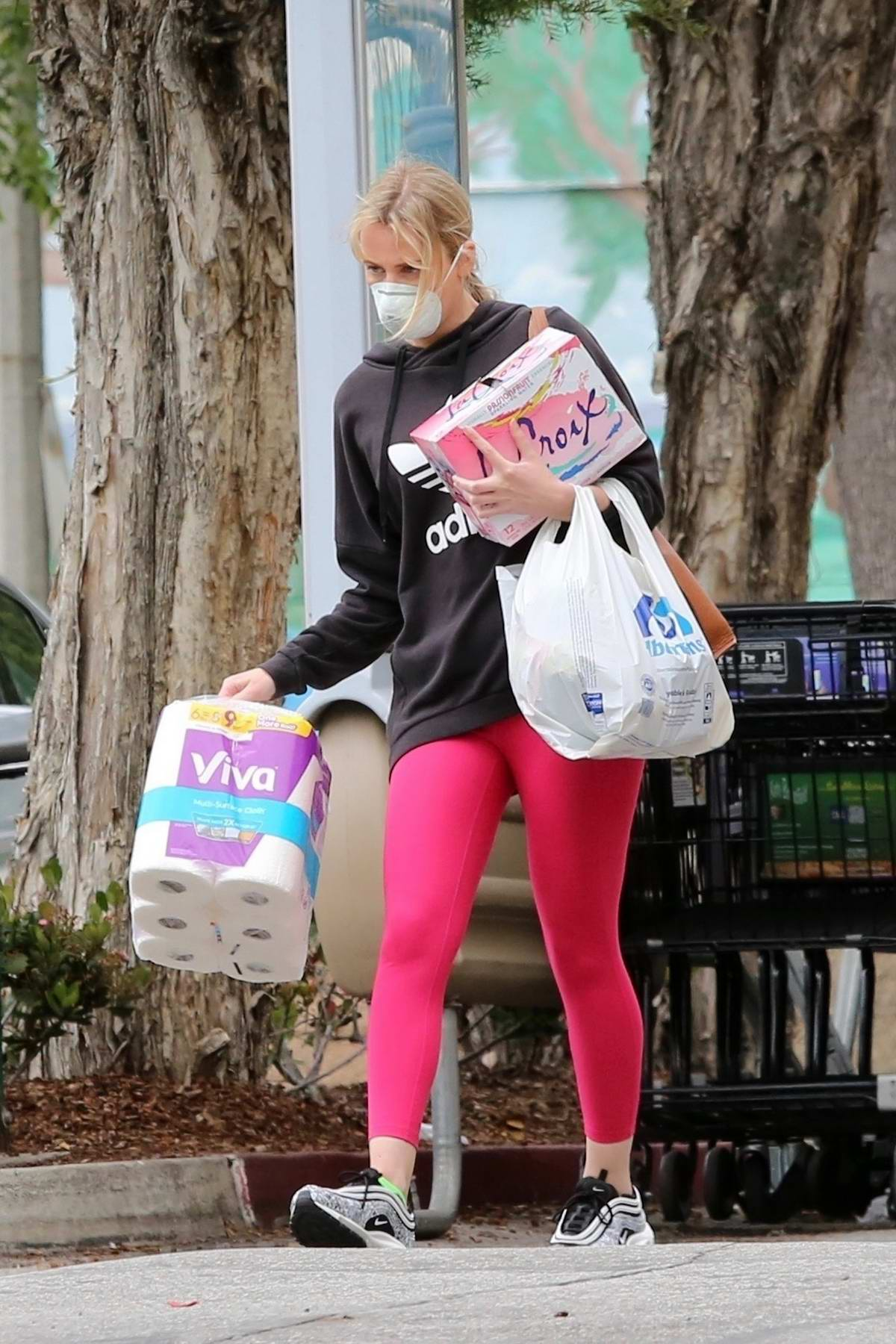 Molly Sims stocks up on sparkling water and toilet paper at Albertsons in Brentwood, California