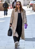 Myleene Klass looks fashionable in a Burberry coat as she arrives at Global Radio Studios in London, UK