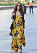 Myleene Klass looks radiant in bright yellow floral dress as she arrives for her show on Smooth Radio in London, UK