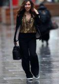Myleene Klass wears an animal print shirt with black pantsuit arrives at Smooth Radio in London, UK