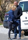 Naomi Watts seen wearing a denim jacket and leggings while out for a walk with Liev Schreiber in The Hamptons, New York