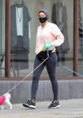 Nicole Murphy wears protective mask and gloves as she takes her dogs out for a stroll in Beverly Hills, California