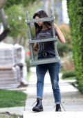 Nina Dobrev seen carrying a few furniture items out to a friend's car in Los Angeles