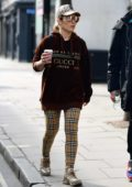 Noomi Rapace sports Gucci hoodie and Burberry check leggings while out shopping at Planet Organic in London, UK