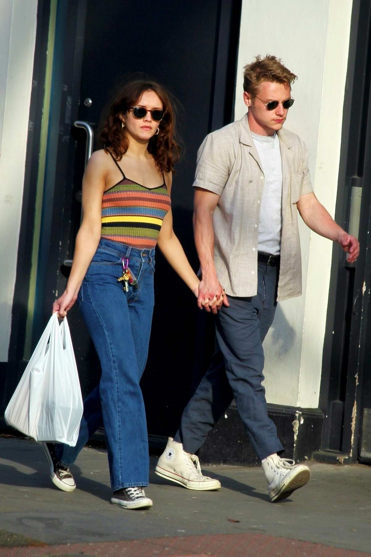 Olivia Cooke and Ben Hardy walk hand in hand as they pick up supplies in Primrose Hills, London, UK