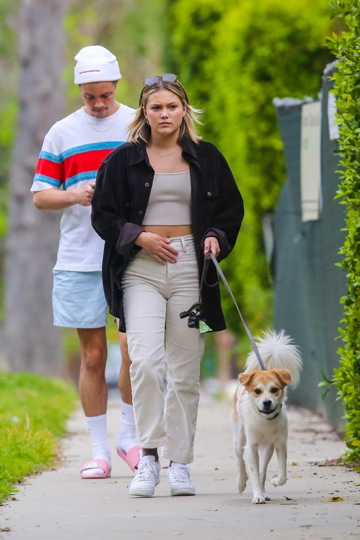Olivia Holt looks great as she steps out to walk her dog with a friend in Los Angeles