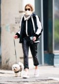 Olivia Palermo looks stylish in monochrome as she steps out for a dog walk in New York City
