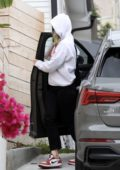 Olivia Wilde goes incognito as she visits a friends house in Los Angeles
