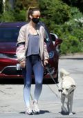 Olivia Wilde looks great in blue tie-dye leggings while out for stroll with her dog in Los Feliz, California