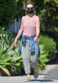 Olivia Wilde obeys to the social distancing guidelines as she takes a walk with a friend in Santa Monica, California