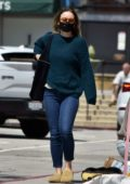 Olivia Wilde steps out in a sweater, jeans and a face mask while out running a few errands in Los Angeles