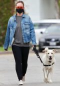 Olivia Wilde wears a mask as she steps out to walk her dog around her neighborhood in Los Angeles