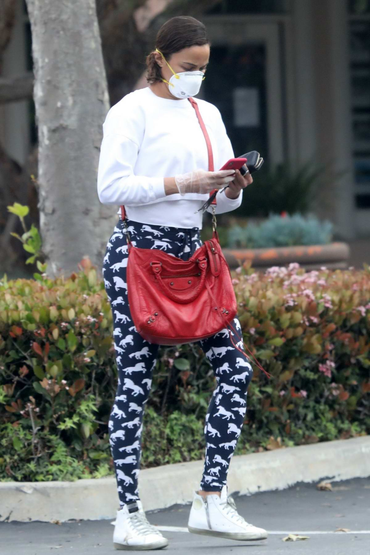 Paula Patton wears a mask and gloves as she goes to the ATM in Malibu, California