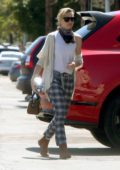 Portia de Rossi looks stylish in checkered pants as she heads to a warehouse in Los Angeles