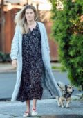 Rachael Taylor steps out for a walk with her dog in Los Angeles