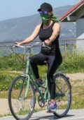 Reese Witherspoon keeps up with her workout routine with a bike ride along the coast in Malibu, California