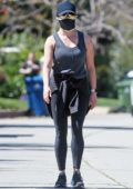 Reese Witherspoon looks toned in leggings as she goes for a run around her neighborhood in Brentwood, California