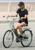 Reese Witherspoon seen wearing black shorts while riding a bicycle in Malibu, California
