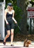 Roosmarijn de Kok wears a black camisole top and bike shorts while out walking her pup in Miami, Florida