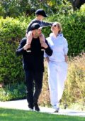 Rosie Huntington-Whiteley and Jason Statham enjoy a walk together with their son in Beverly Hills, California