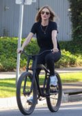 Rosie Huntington-Whiteley looks casual yet trendy while out for a bike ride in Beverly Hills, California