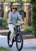 Rosie Huntington-Whiteley takes a break from self-isolation and enjoys a bike ride in Los Angeles