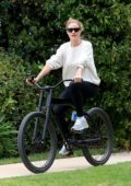 Rosie Huntington-Whiteley wears a cream sweatshirt and black leggings while enjoying a bike ride in Beverly Hills, California