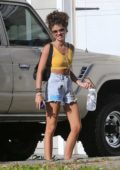 Sarah Hyland seen wearing a yellow crop top and denim cut-offs as she arrives back from a dog park in Los Angeles
