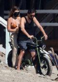 Sofia Richie and Scott Disick enjoy a motorbike ride on the beach in Malibu, California