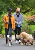 Sophie Turner and Joe Jonas seen wearing matching black masks while walking their dogs in Los Angeles
