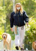 Sophie Turner shows her growing baby bump while out walking her dogs with Joe Jonas in Los Angeles