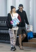 Suki Waterhouse and Robert Pattinson step out to stock up on some supplies in London, UK