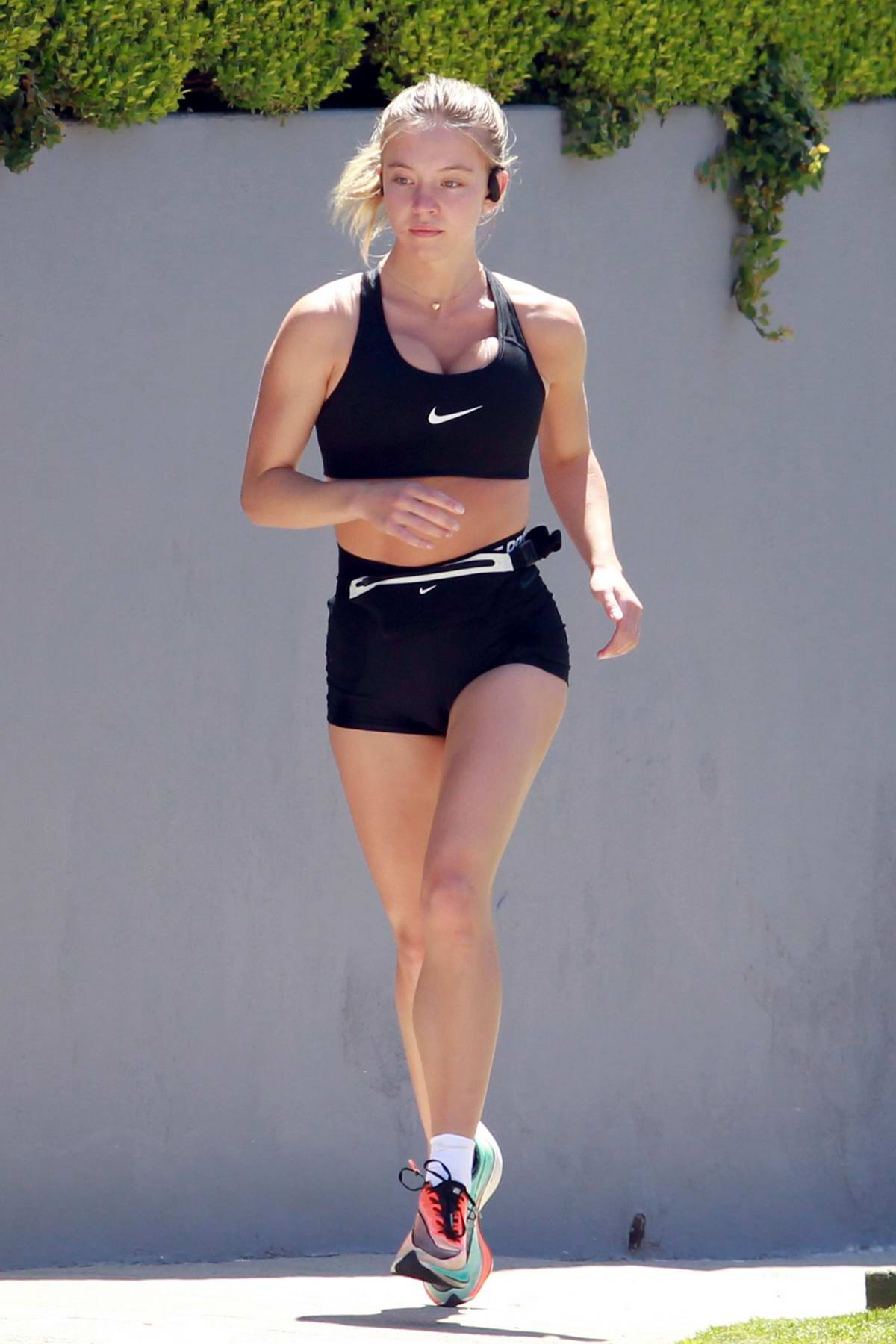 Sydney Sweeney shows off her fabulous figure while out for a run with a mystery man in Los Angeles