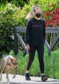 Teresa Palmer seen wearing black sweatshirt and leggings as she takes a stroll with her dog in Los Angeles