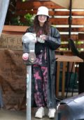 Vanessa Hudgens steps out in the rain to pick up some take-out in Los Angeles