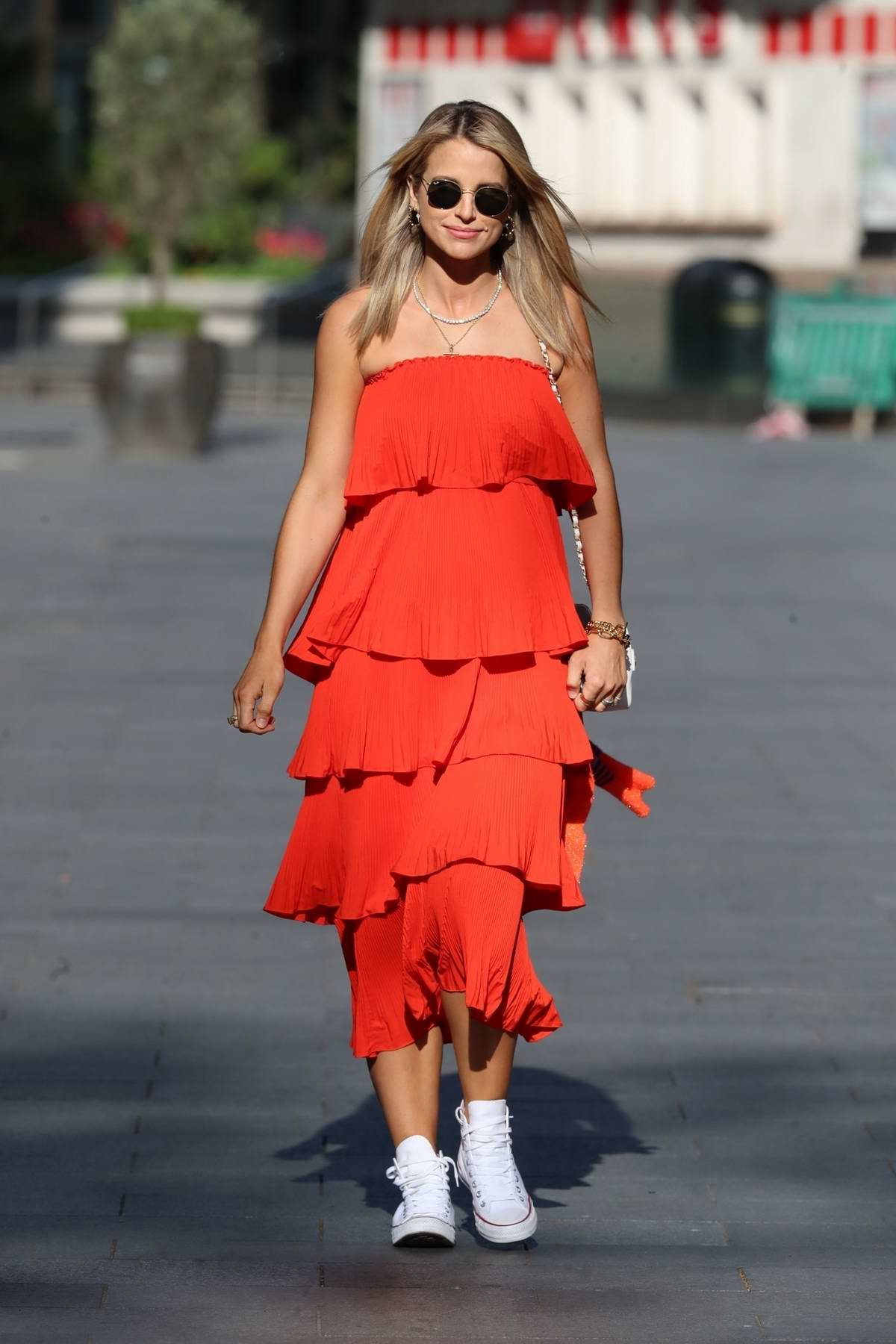 Vogue Williams looks striking in a red dress as she leaves the Heart Radio Studios in London, UK