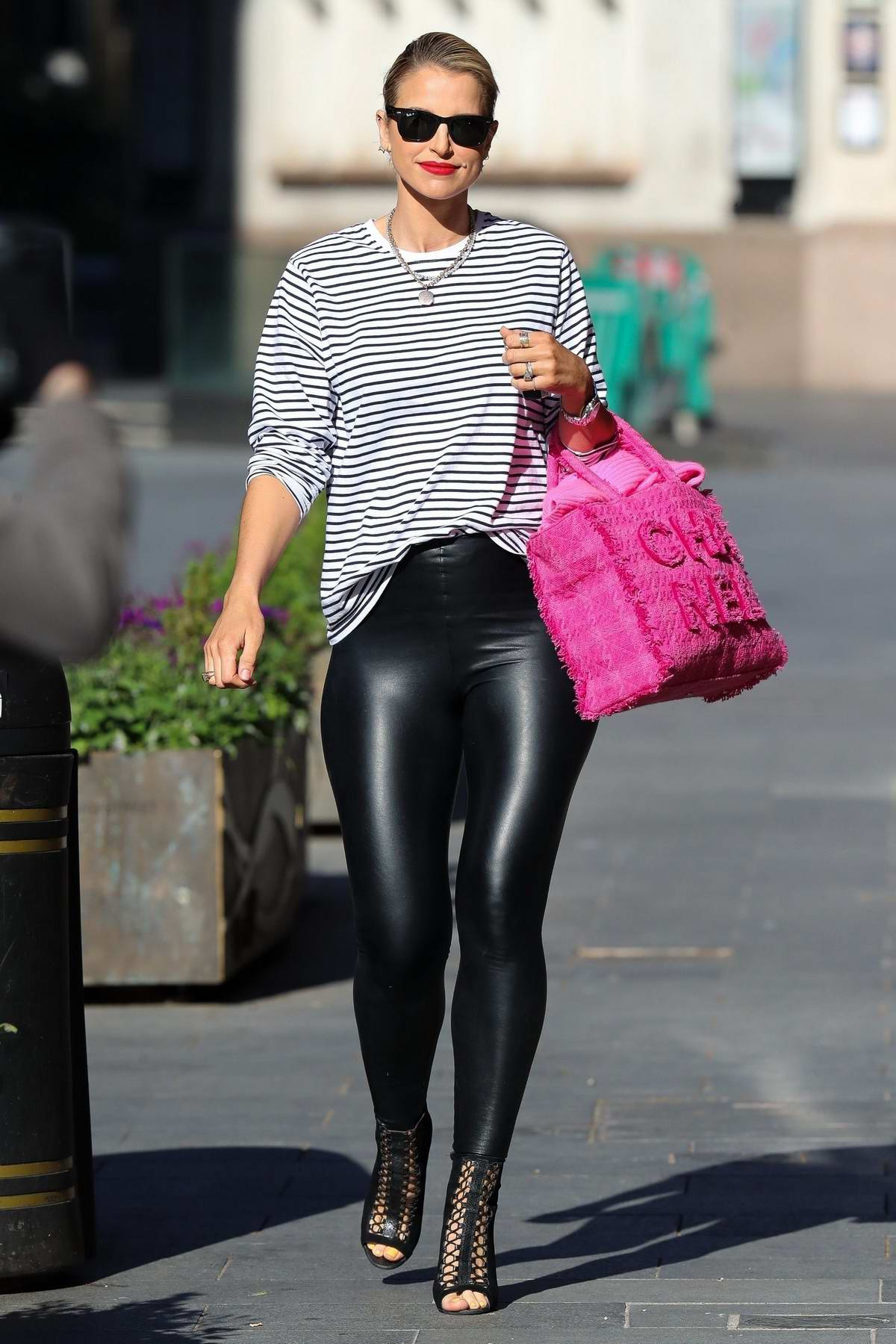 Vogue Williams looks stylish in PVC Leggings and striped top as she leaves Heart Radio in London, UK