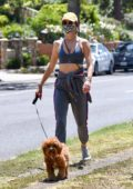 Alessandra Ambrosio looks fab in a VSX sports bra while out to walk her dogs in Santa Monica, California