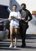 Alessandra Ambrosio rocks denim shorts and sweatshirt for a grocery run at Erewhon Organic in Santa Monica, California