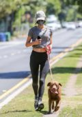 Alessandra Ambrosio sports a grey top and black leggings while out for a run with her dog in Los Angeles