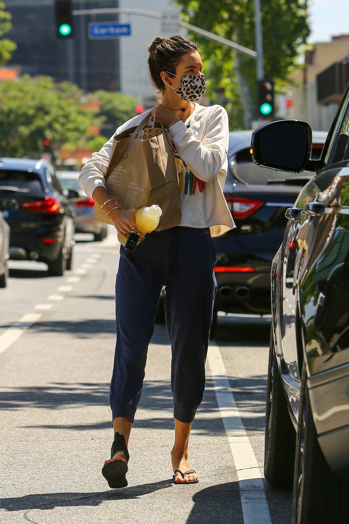 Alessandra Ambrosio wears an animal print mask while out picking up lunch at Kreation Restaurant in Brentwood, California