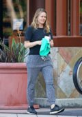 Alicia Silverstone keeps it casual and makeup free during a coffee run in Los Angeles