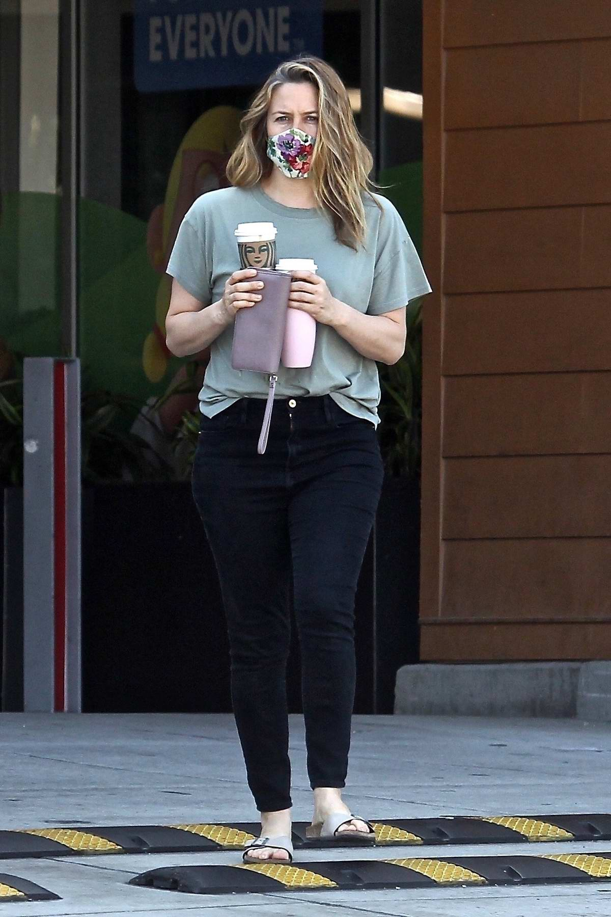 Alicia Silverstone stops to grab a couple of coffees at a local Starbucks in Beverly Hills, California