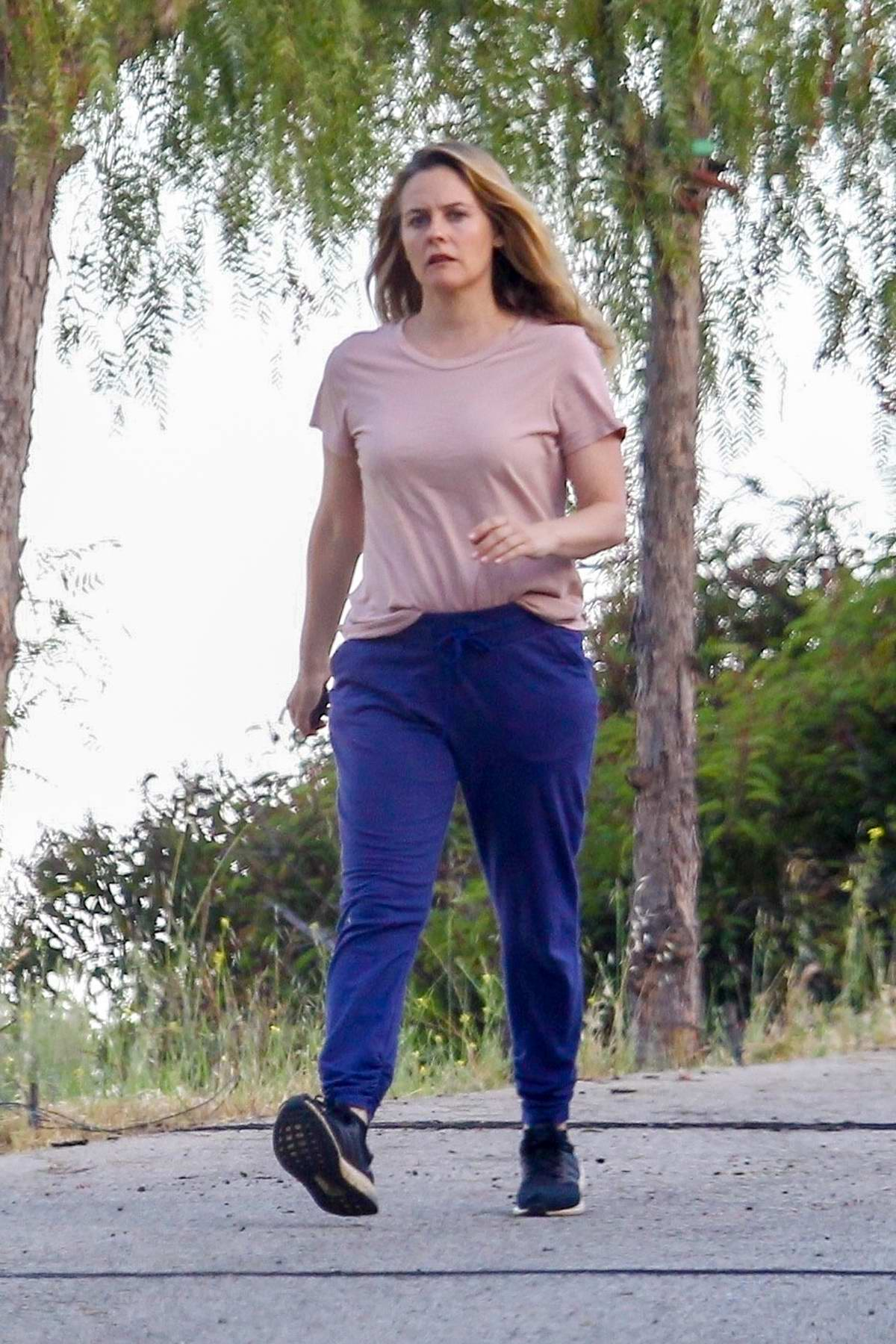 Alicia Silverstone takes her dogs out for a walk with her boyfriend in Beverly Hills, California
